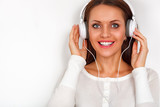 smiling woman with headphones relax with music