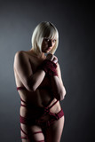 Sensual roped blonde posing looking at camera