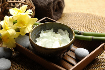 Spa aroma bowl of salt and orchid with towel on mat
