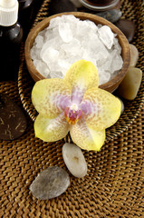 Spa aroma bowl of salt and orchid  and stones on mat