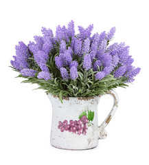 Jug with wild flowers isolated on white background