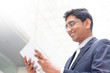 Indian businessman using digital tablet pc
