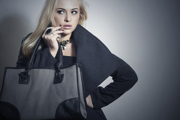 Beautiful Blond Woman in Topcoat with Handbag.Spring Shopping