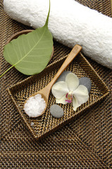 spoon spa salt and stone in bowl with towel on mat