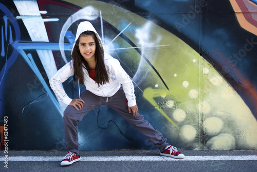 Foto op Canvas Dance School Dancing girl on a city street