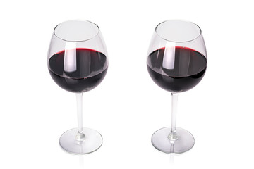 Glasses of red wine isolated on white background