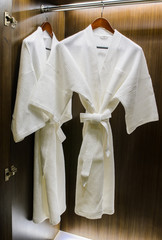Bathrobes in the closet in the hotel.