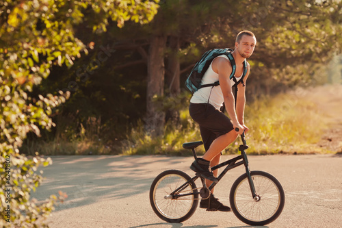 Young man sitting on bike