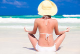 closeup back view young woman in bikini and hat posing yoga on