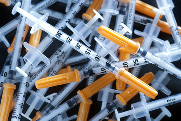 pile of syringes for diabetes