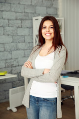 Young smiling woman standing at office
