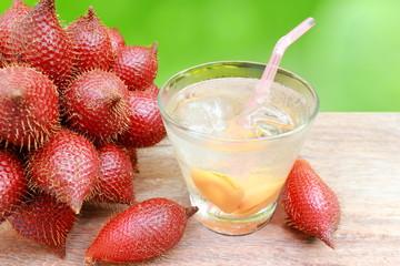 Close up zalacca fruit and zalacca juice in glass.