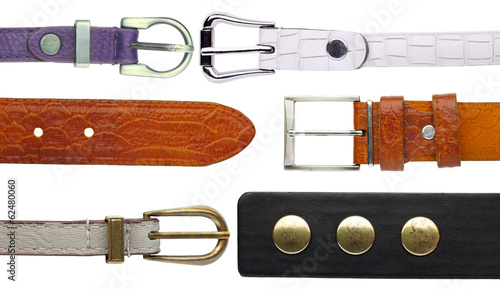 Set of various leather belt isolated on white background.