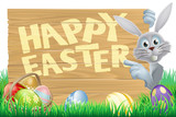 Bunny pointing at Happy Easter message