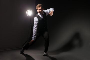 modern style dancer dancing on dark background