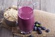 Leinwandbild Motiv Smoothie with blueberries and oatmeal