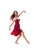 Young ballet dancer wearing red dress isolated