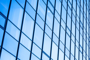 Moder office facade with blue glass ans steel frames
