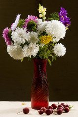 vase with a bouquet of multicolored aster