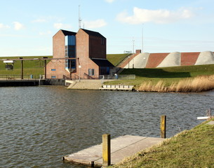 Pumping station and wooden pier in Noordpolderzijl