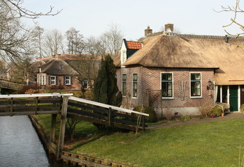 House and wooden bridge  in Giethoorn