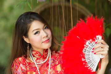 Beautiful Asian girl with Chinese traditional dress Cheongsam