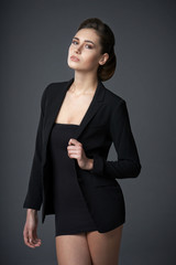 Fashion woman in black dress and jacket