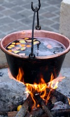 huge copper cauldron with the tasty mulled wine