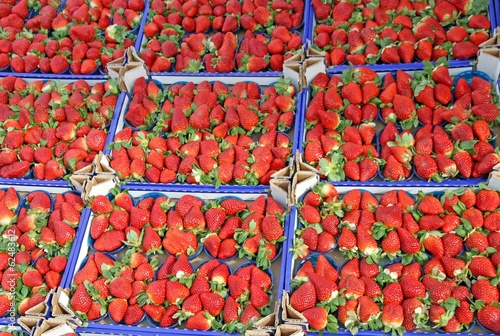 boxes full of juicy red strawberries and sold at local market