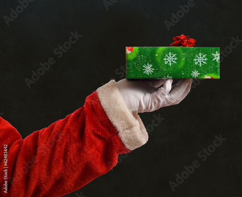 Santa Father Christmas hand with present
