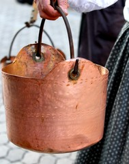 copper pot carried by a peasant woman to the rural village
