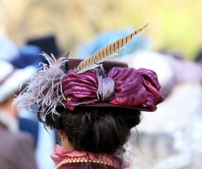 elegant lady hat adorned with a feather of a pheasant