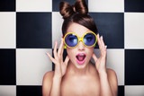Attractive surprised young woman wearing sunglasses - 62485014