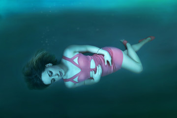Deep water woman adrift underwater