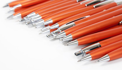 orange pens background