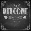 Welcome written on chalkboard