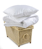 pillow and blanket on wicker basket