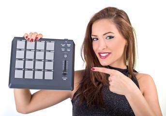 Beautiful young woman posing with audio equipment