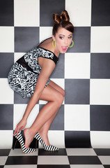 Attractive surprised young woman wearing high heels