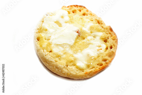 Buttered English Muffin Isolated on White
