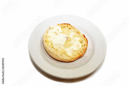 Buttered English Muffin on a Round Plate