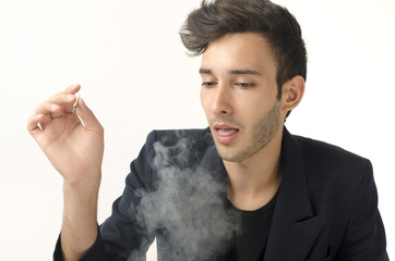 Young beautiful businessman smoking a cigar, tabacco addiction