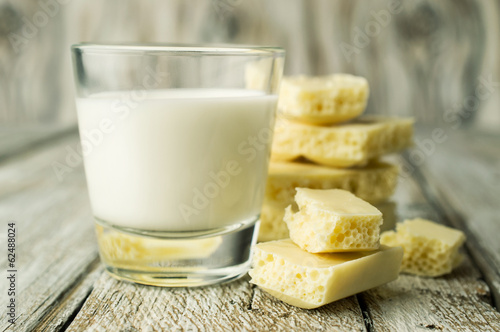 white porous chocolate and a glass of milk