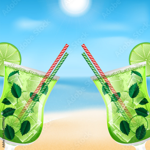 two glasses with cocktails on the background of sea and sky.summ