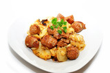 Fried Sausage with Potatoes Served on a Plate