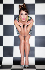 Attractive surprised young woman wearing stripy high heels