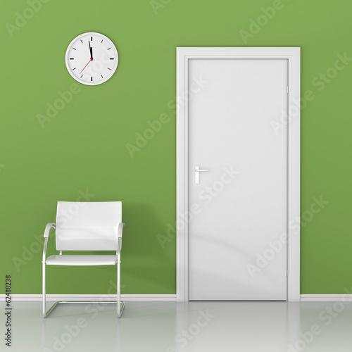 A wall clock and white chair in the waiting room. Wait here!