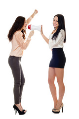 two smiling young women crying in megaphone