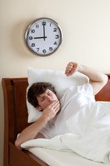 Waking up and yawning man