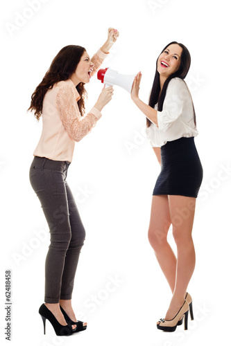 two smiling standing women crying in megaphone
